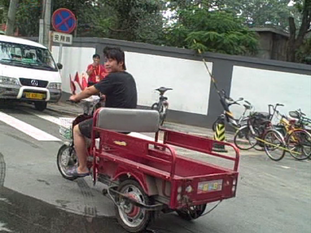 Olympic Pedicab fella pulling Brad Blanks around Beijing