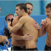 Michael Phelps talks with Brad Blanks at packed Beijing Press Conference